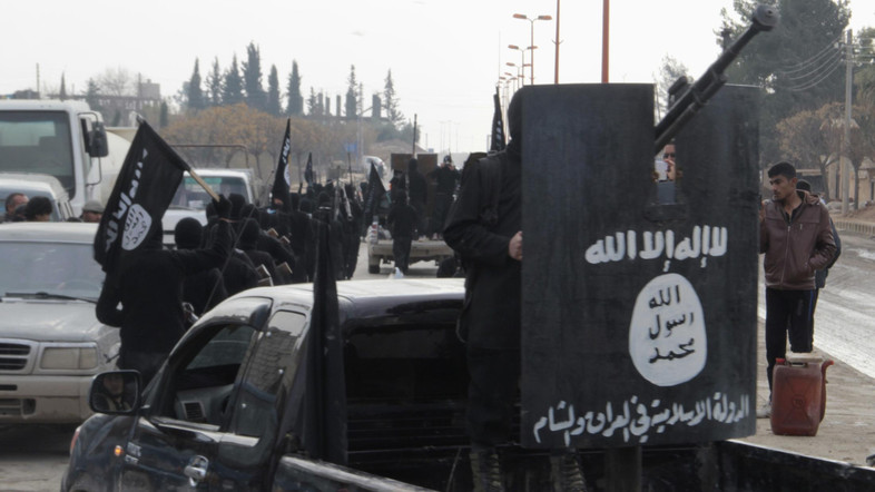 Fighters of al-Qaeda linked Islamic State of Iraq and the Levant parade at the Syrian town of Tel Abyad